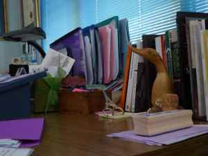 Books, files, and artefacts on author Amanda Curtin's desk