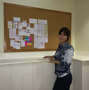 E. J. Koh laying out ideas on a bulletin board