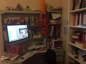 Desk, computer, and bookshelves of Rachael Johns