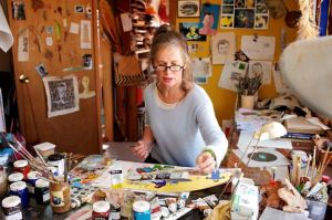 Tina Matthews' workspace with art materials