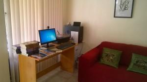 Computer, desk and sofa in Karen's workspace