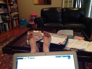 Michelle Ray's feet up with a laptop in her living room