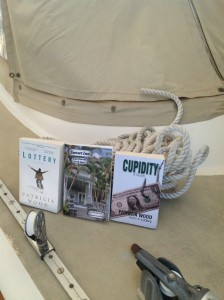 Patricia's books on the deck of sailboat Orion