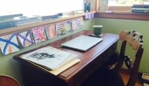 Desk and laptop of writer Julie Trimingham