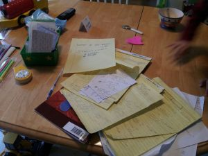 Table covered in paperwork, kids' breakfast etc.