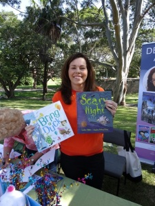 Lesley Gibbes showing off her books
