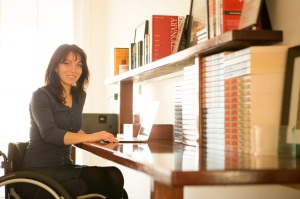 Writer Honey Brown at her desk
