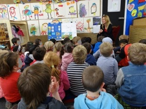 Nicole Melanson doing an author visit about poetry with preschoolers