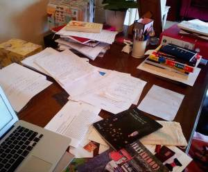 Jessica's desk covered in papers