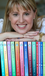 Jacqueline with a collection of her books