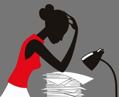 Woman working through a stack of papers