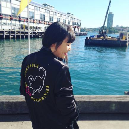 Julie Koh wearing a jacket inspired by The Portable Curiosities