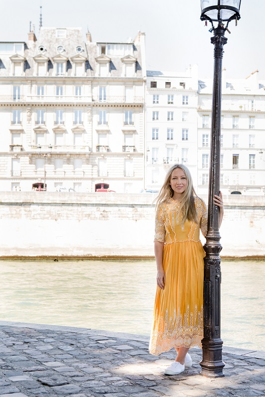 Writer and beauty blogger Katrina Lawrence in front of the Seine