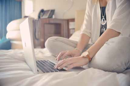 Woman typing in hotel