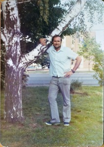Nicole Melanson's father in front of a tree